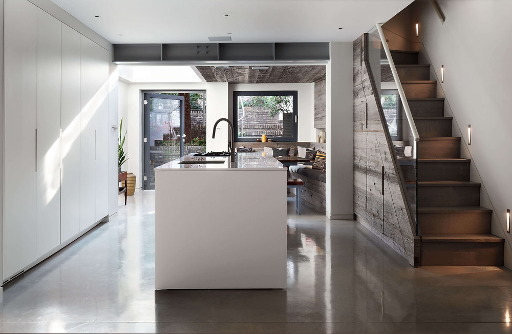 Boffi contemporary kitchen island in basement design by Catherine Wilman Interiors with polished concrete floor
