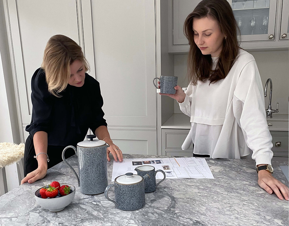 Catherine Wilman Interiors discuss a plan as they have a coffee break with Denby mugs