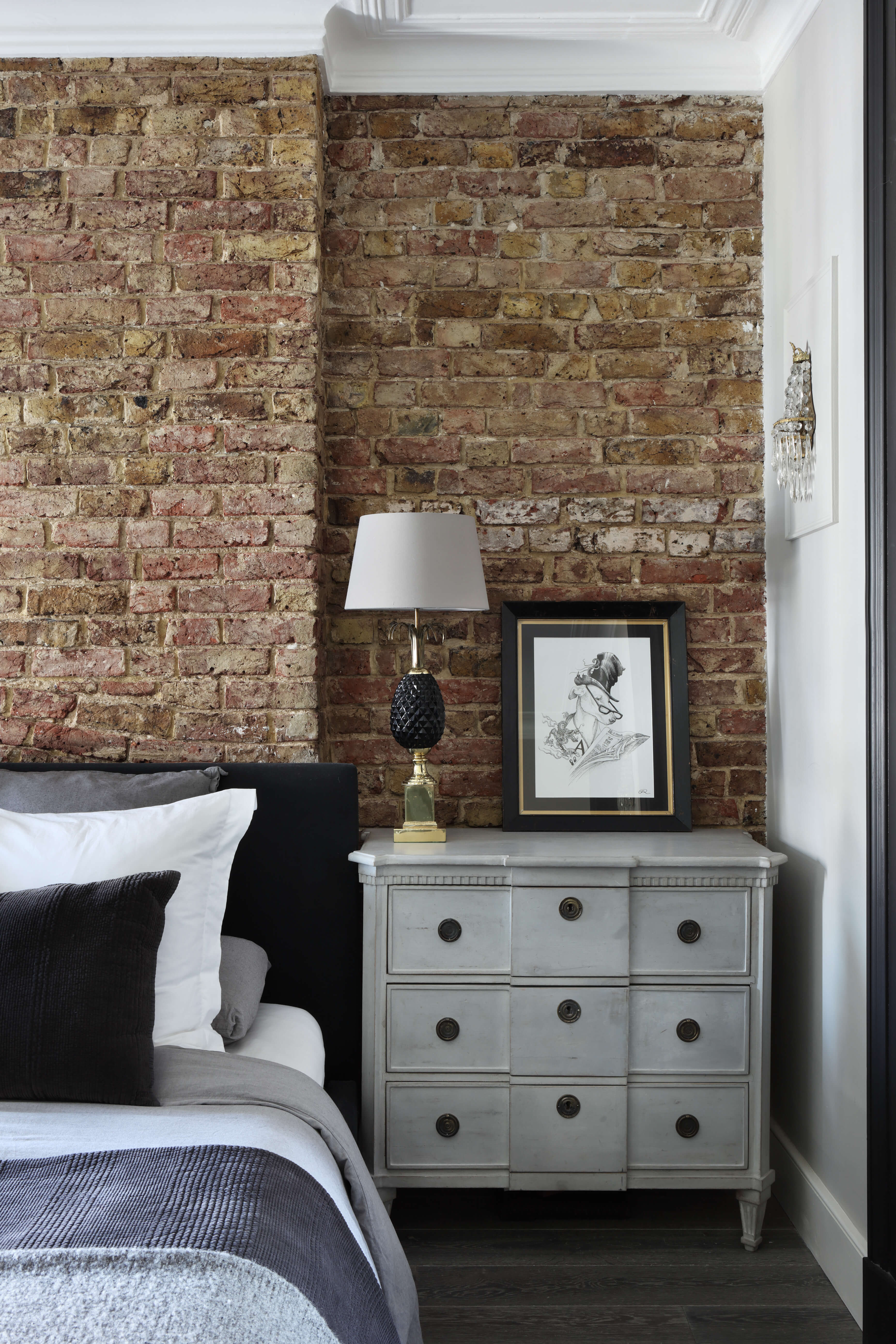 Exposed brickwork and bedside lamp