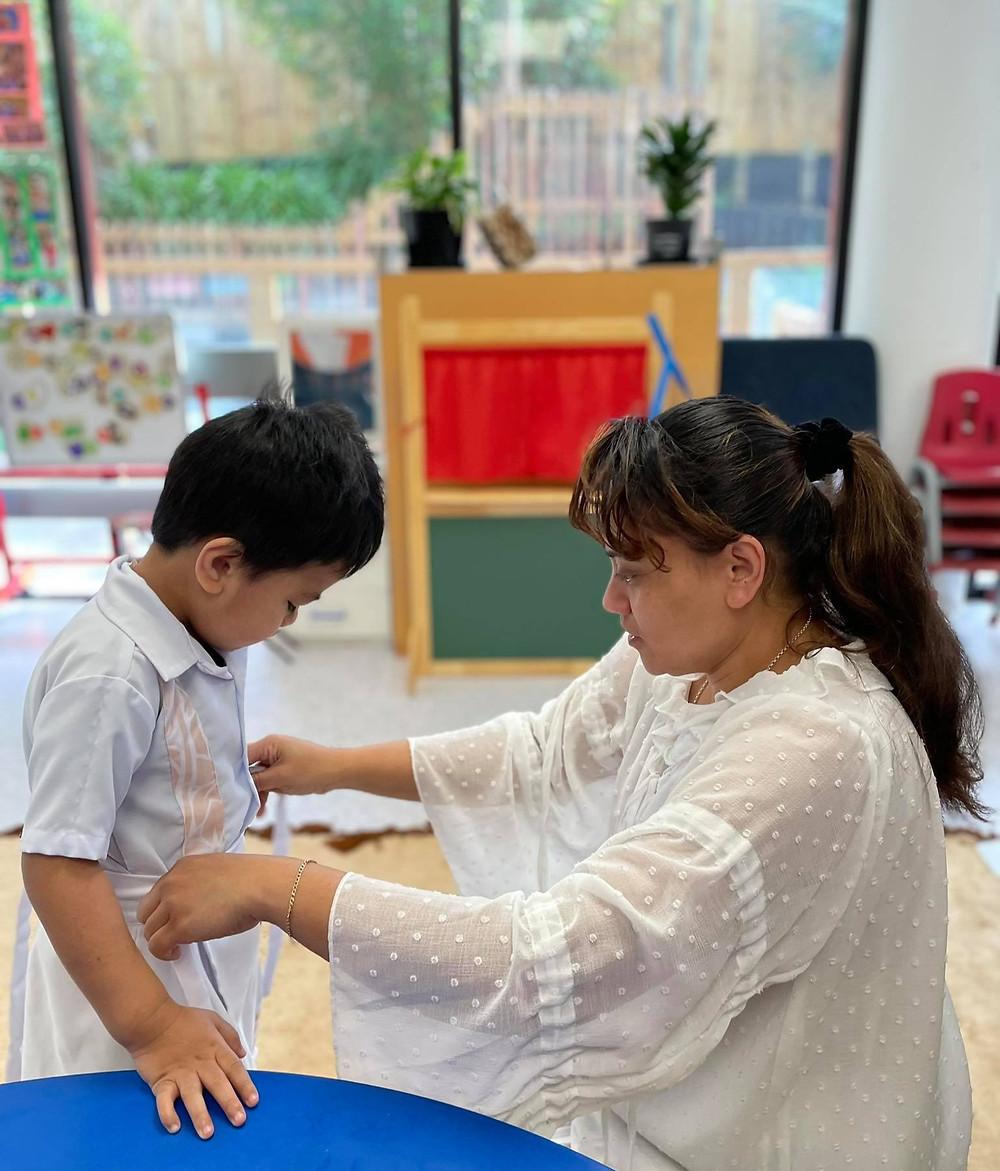 Teacher helps child get ready