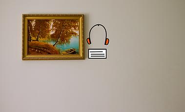 Un quadro con una didascalia e delle cuffie