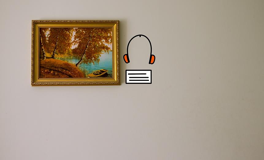 Un quadro con di fianco una didascalia e un paio di cuffie