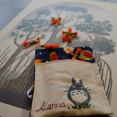 worry dolls in a Totoro bag