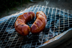 two-sausages-on-charcoal-grill-1275692.j
