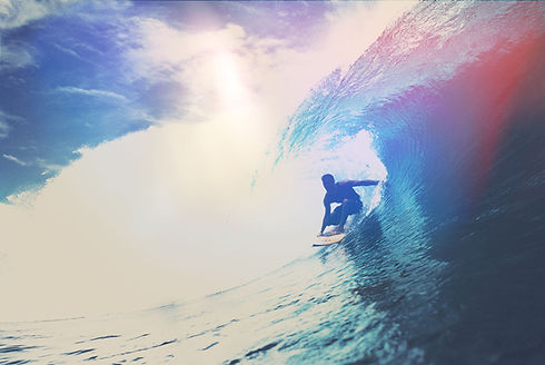 Surfer riding wave