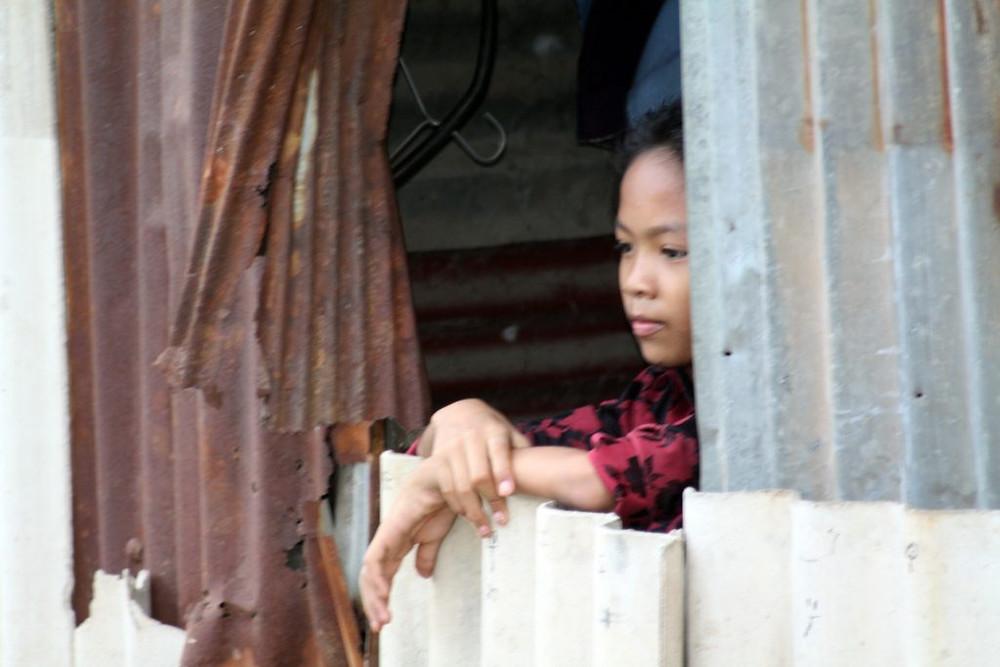 Habitante d'un bidonville à Phnom Penh