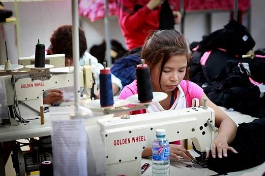 87 % des litiges concernent le secteur du textile et du tourisme. Photographie ILO