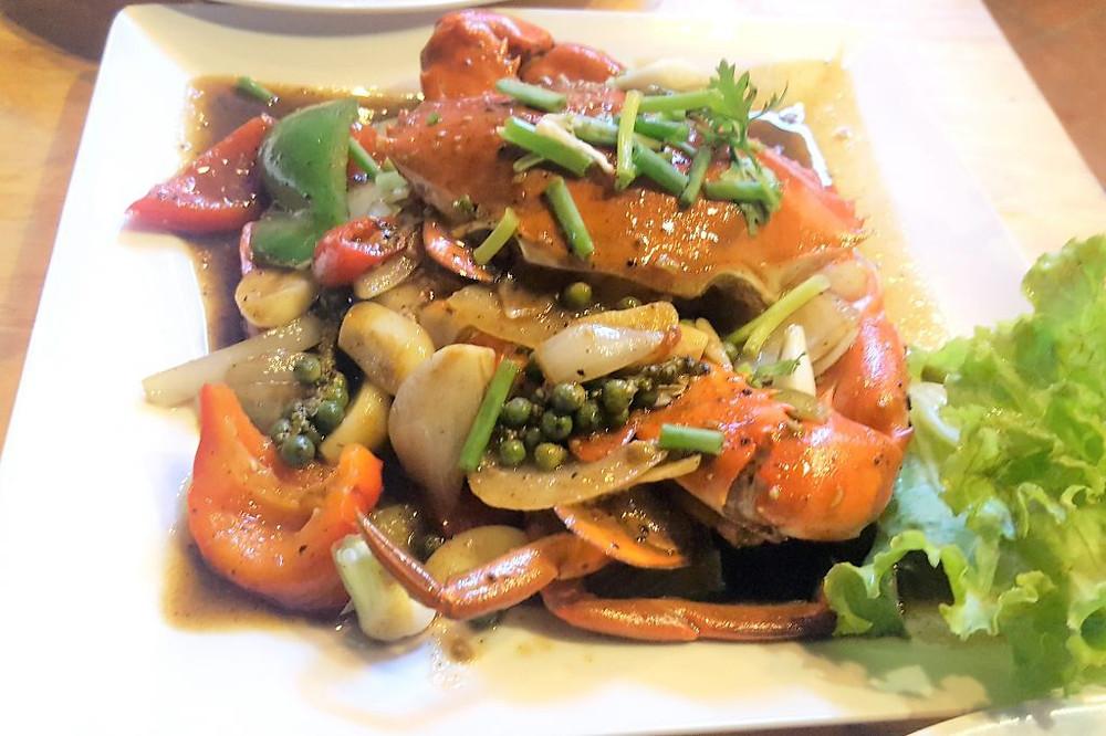 Crabe sauté au poivre vert