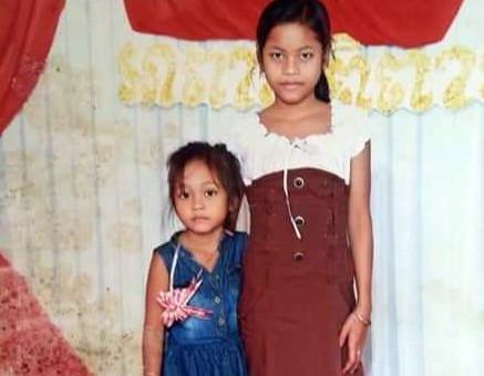 Srey Leakhana, âgée de 14 ans, et sa petite soeur, Srey Meta, âgée de 7 ans