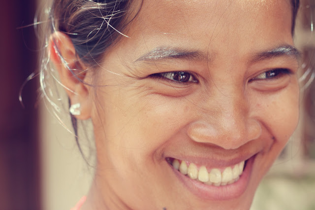 Sourire khmer. Photographie par ND Strupler