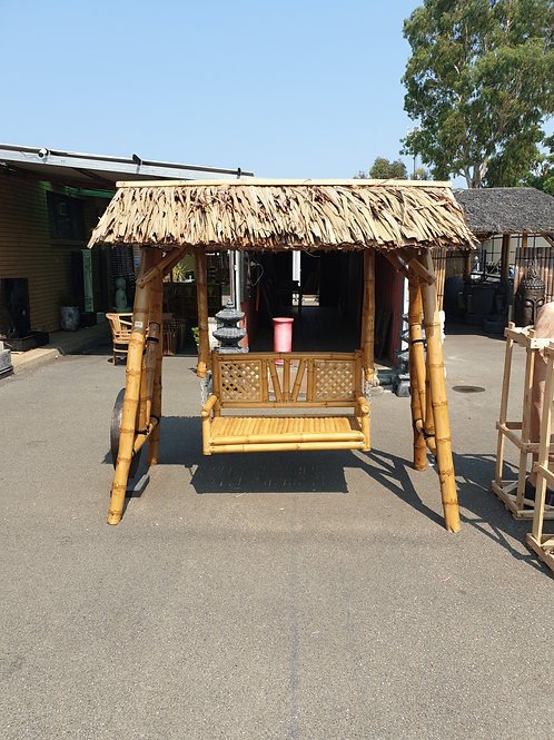Bamboo swing with thatch