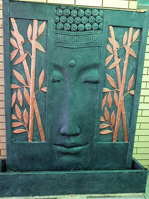 Buddha face in bamboo water feature