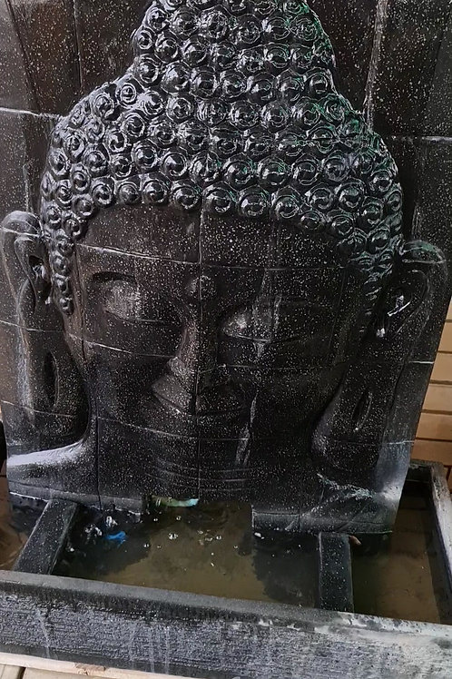 Cracking Buddha face water feature