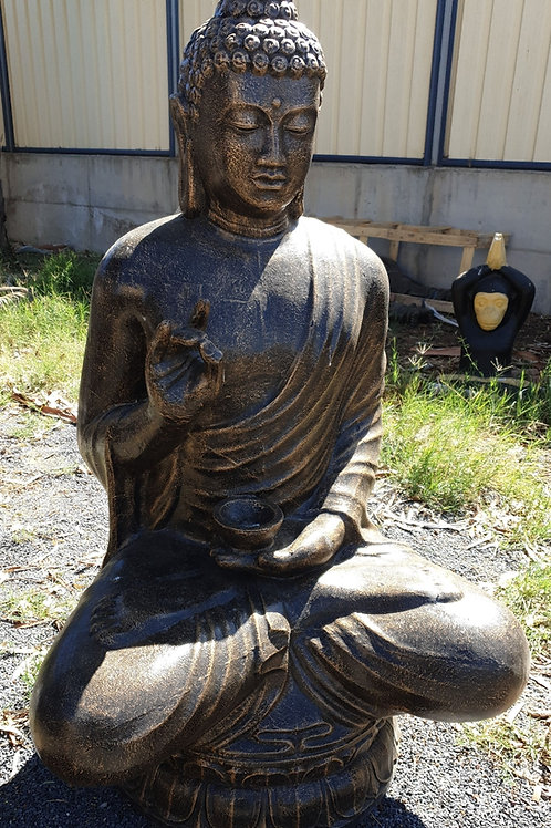 Sitting Buddha candle in one hand