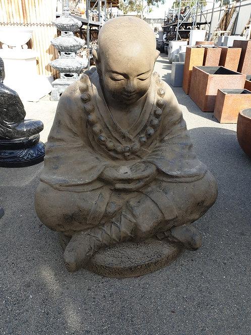 Monk hands in his lap