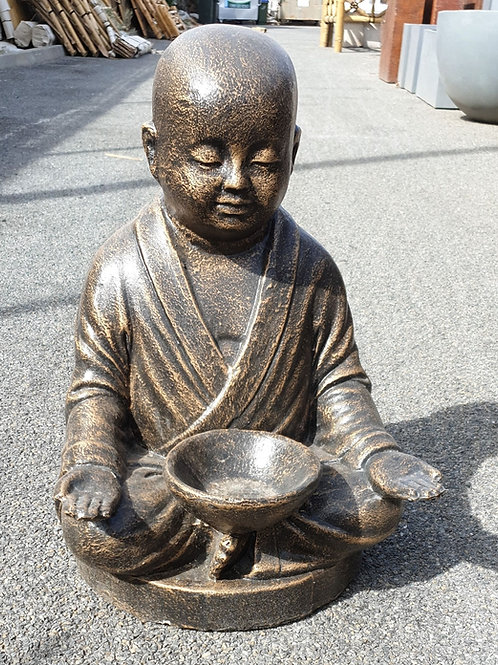 Monk with a candle in lap