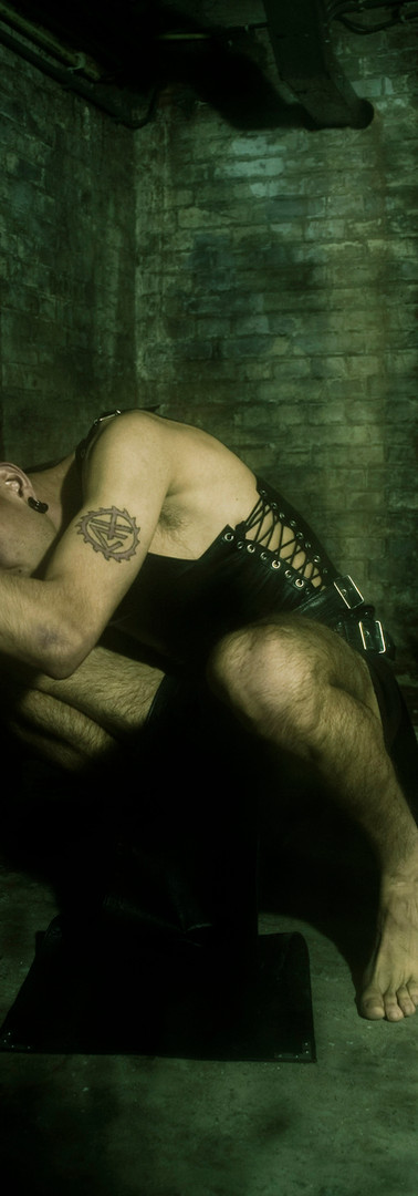 Male leather and laced up top, bondage