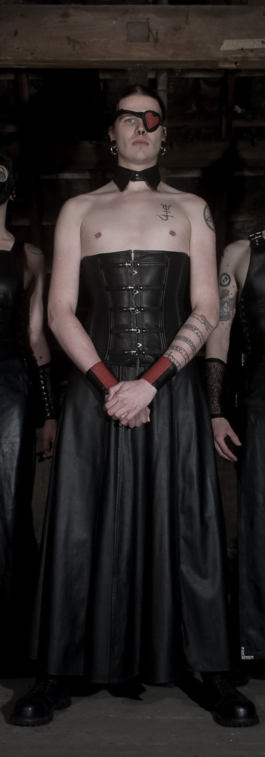 Breathcatchers. Male leather skirts and male leather corset