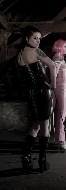 Breathcatchers. Pink leather monoglove, domina in corsetdress