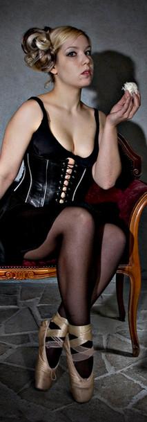 Breathcatchers. Girl eatingTurkish delight with leather corset