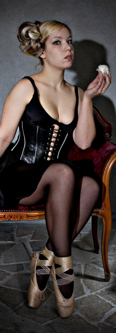 Breathcatchers. Girl eatingTurkish delight with leather corset