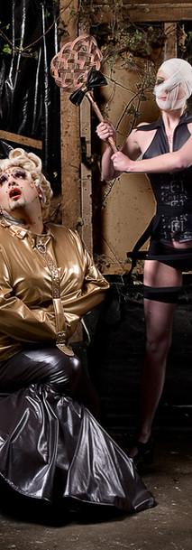 Drag in golden straitjacket