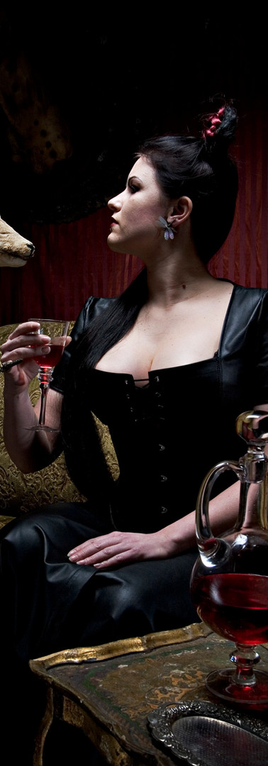 Breathcatchers leather domina drinking wine with her pet
