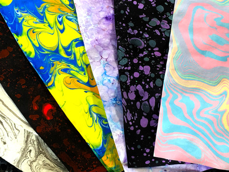Various marbled papers showcasing different types of marbling
