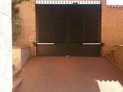 Puerta batiente de dos hojas con lam