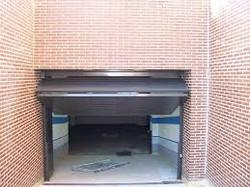 Puerta basculante entrada a garajes comunidatio