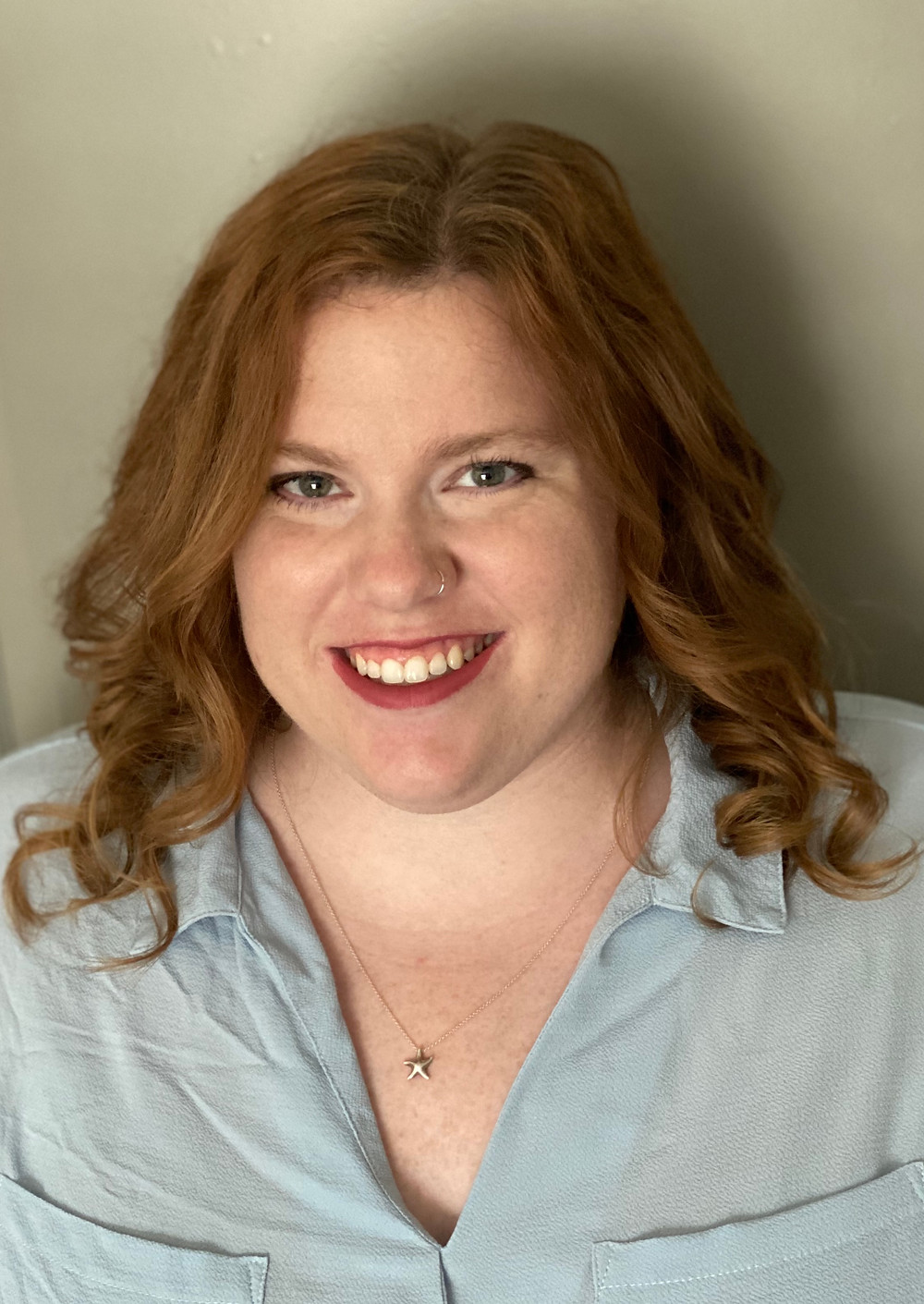 A headshot of Aly Trevino- October Member of the Month