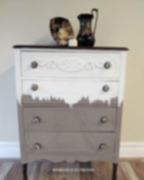 Antique dresser has been updated in neut