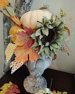 Making Fall arrangements for my booth..