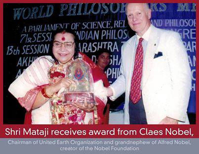 Photo of H H Shri Mataji Nirmala receiving an award from Claes Nobel