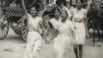 A photo of Shri Mataji at a 'Free India' rally.  She is walking with a group of young ladies