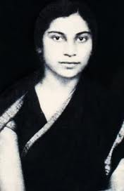 Photo of Shri Mataji in her young days in a black sari