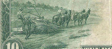 The back to the 10 dollar bill showing Horses pulling a cart with Hemp on it .