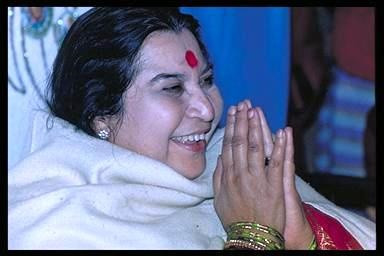 Shri Mataji saying Namaste (hands together in a prayer position - a form of greeting.