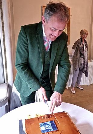 Actor Hugh Bonneville cutting the cake!