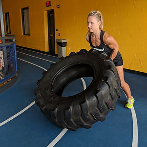 Tire flip online personal trainer elite animal fitness crossfit strength training