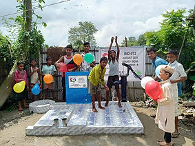 Young children celebrating installation of a water well