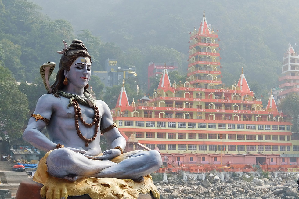 Statue of Shiva sitting in meditation on