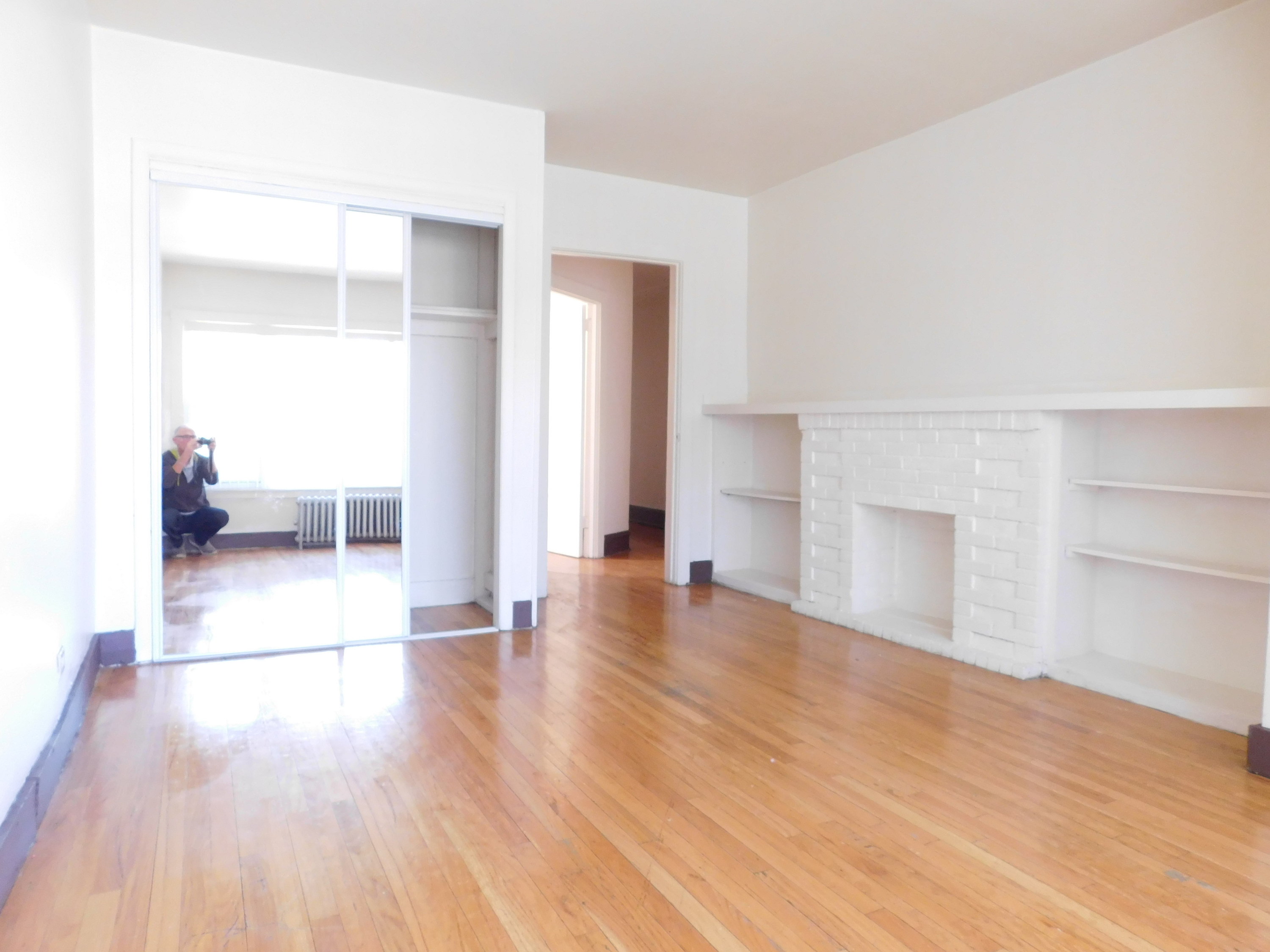 2 bedroom in Austin Chicago utilities included - decorative fireplace in living room