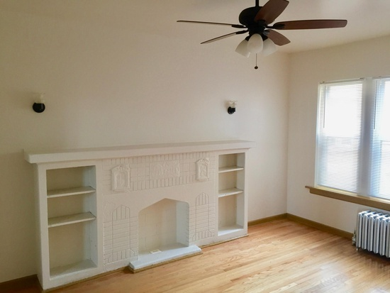 10 N Long, Chicago, IL 60644, Living room with decorative fireplace