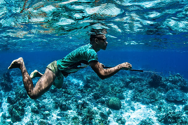 Filipino spearfisher under the water waiting for a fish to catch