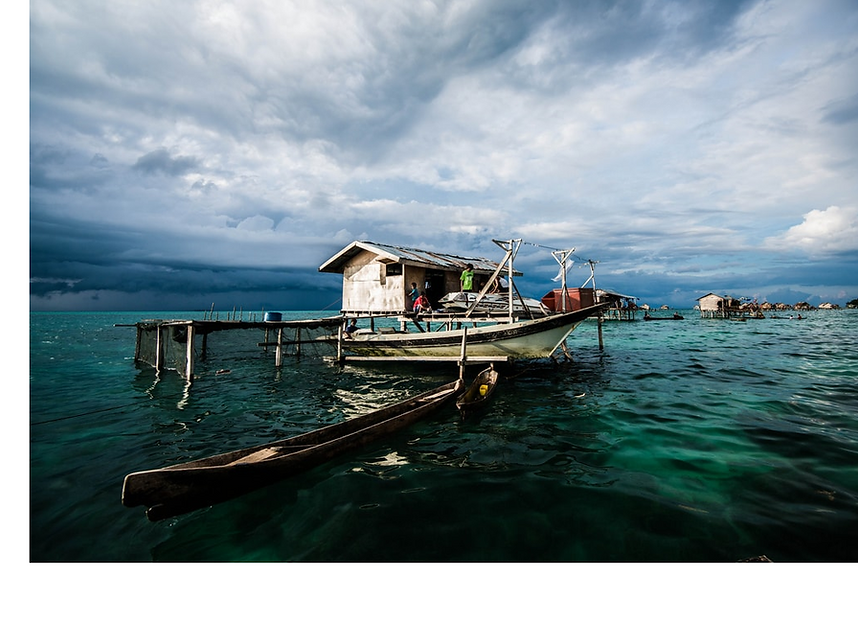 local communities living on a wooden house in the sea