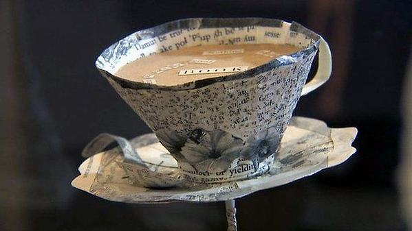 coffeed cup with word books inside.png