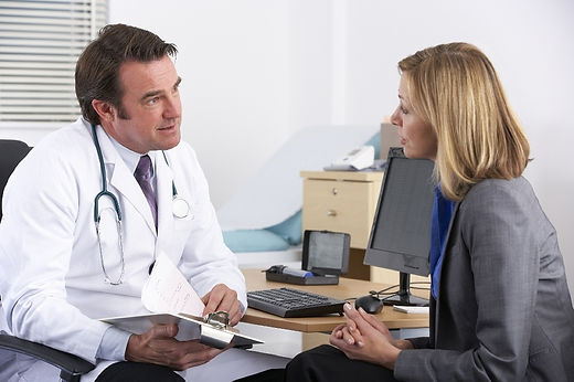 Female patient and male doctor.jpeg