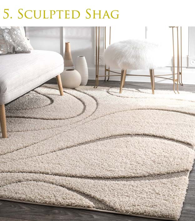 Sculpted plush hand tufted rug