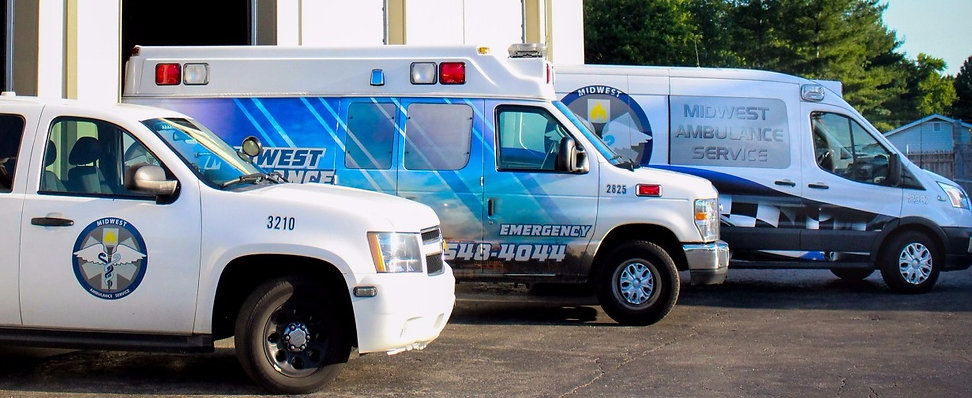 Two ambulances and our Tahoe in front of our station.